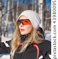 Young adult woman snowboarder holding snow board 43980095
