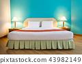 Clean towel on bed in interior bedroom 43982149