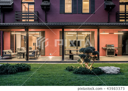 Two storey country house with luminous lamps 43983373