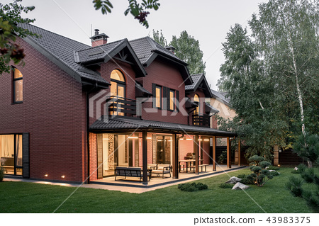 Two storey country house with luminous lamps 43983375