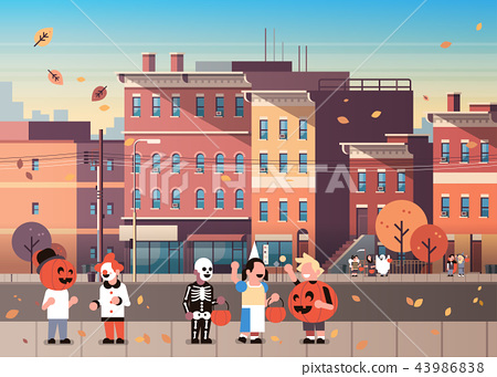 kids wearing monsters costumes walking town holiday concept cityscape background tricks or treat 43986838