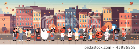 kids wearing monsters costumes walking town holiday concept cityscape background tricks or treat 43986858