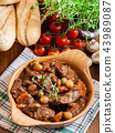 Beef Bourguignon stew served with baguette 43989087