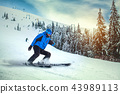 Man skier on a slope in the mountains 43989113