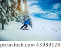 Man skier on a slope in the mountains 43989120