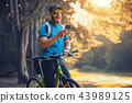 bearded man cyclist rides in the forest on a mountain bike. 43989125