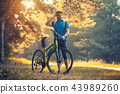 bearded man cyclist rides in the forest on a mountain bike. 43989260