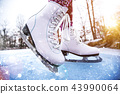 Close-up of woman ice skating on a pond. 43990064