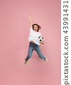 Forward to the victory.The young woman as soccer football player jumping and kicking the ball at 43991431