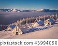 Old wooden houses in winter mountains 43994090