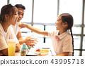 Happy family  enjoying dinner in restaurant. 43995718