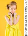 Portrait of a blonde girl in waist. 43997087