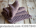 Brown knitted wooden scarf 43997840
