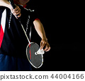 player holding the  racket and shuttle cock 44004166