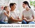 girl, her mother and grandmother 44005180