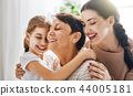 girl, her mother and grandmother 44005181