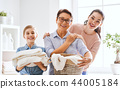 family doing laundry at home 44005184