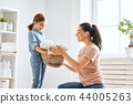 family doing laundry at home 44005263