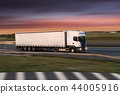Truck with container on road, cargo transportation concept. 44005916