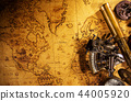 Old vintage navigation equipment on old world map. 44005920
