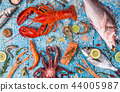 Fresh tasty seafood served on old wooden table. 44005987