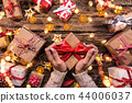 Top view of woman hands with gift box. 44006037