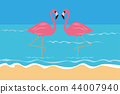 couple pink tropical flamingos on the beach in the water 44007940