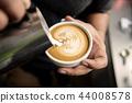 Barista making coffee latte art or Cappuccino 44008578