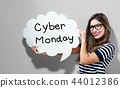 Cyber Monday text with woman holding a speech bubble 44012386