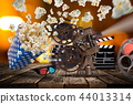 Pop-corn, movie tickets, clapperboard and other things in motion. 44013314