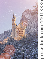 Neuschwanstein Castle during sunrise in winter landscape. 44013336
