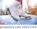 Close-up of woman ice skating on a pond. 44013356