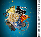 Pop-corn, movie tickets, clapperboard and other things in motion. 44013358