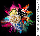 Pop-corn, movie tickets, clapperboard and other things in motion. 44013374