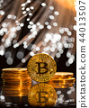 Bitcoin gold coins with defocused abstract background. Virtual cryptocurrency concept. 44013507