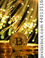 Bitcoin gold coins with defocused abstract background. Virtual cryptocurrency concept. 44013516