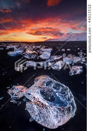 Beautiful sunset over famous Diamond beach, Iceland. 44013518