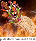 Kebab sandwich with flying ingredients. 44013838