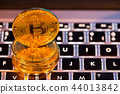 Bitcoin gold coins with laptop keyboard. Virtual cryptocurrency concept. 44013842