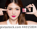 woman and eyeshadow tray 44015804