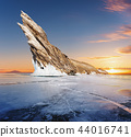 Cracked frozen lake with mountain on lake Baikal 44016741