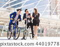 Businessmen riding bicycles 44019778