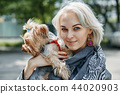 a Portrait of a young woman with a little dog 44020903