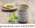 Cup of green tea with Japanese dessert on wooden 44020983