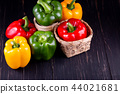 Three sweet peppers on a wooden background, 44021681