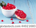 Ripe pomegranate fruits on the wooden background 44021683