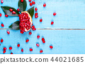 Ripe pomegranate fruits on the wooden background 44021685