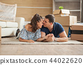 Couple lying happy on the floor on their new house 44022620