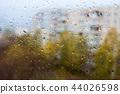rain outside the window, drops of rain on the windowpane 44026598