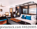 Tropical Resort bedroom interior with wooden bed 44026905